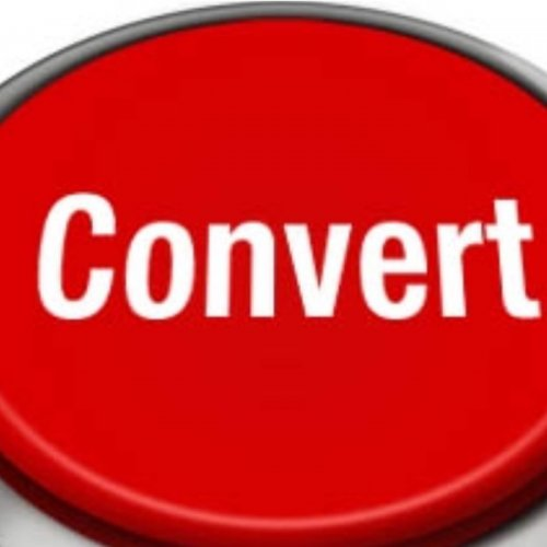 a big red button with the words convert