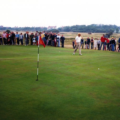photograph of a golfer on the 18 hole at Royal Liverpool Golf Club