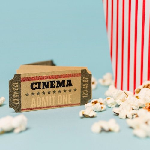 graphic showing a cinema ticket and box of popcorn