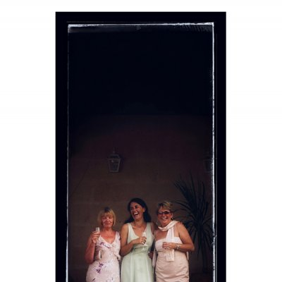 photograph of three ladies at a wedding reception