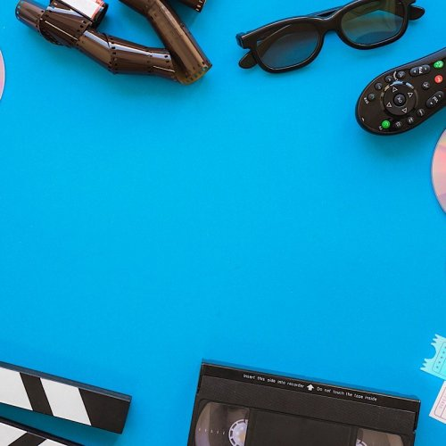 photograph of a blue background with various objects around the edge such as a vis tape, controller