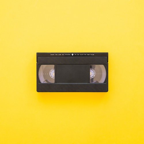 photograph of a vhs tape on a yellow background